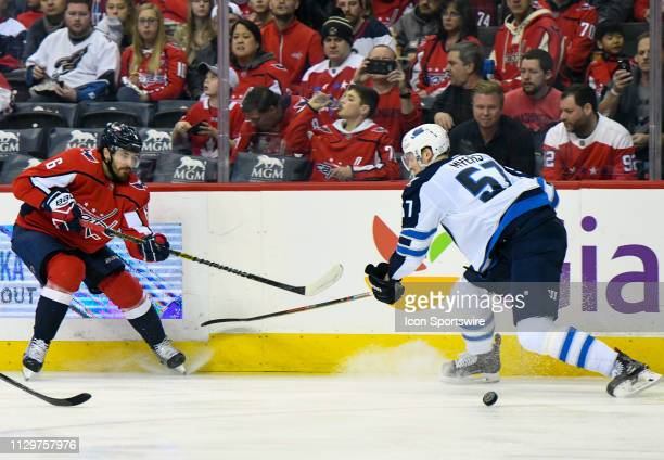 Washington Capitals defenseman Michal Kempny makes a second period pass against Winnipeg Jets defenseman Tyler Myers on March 10 at the Capital One...