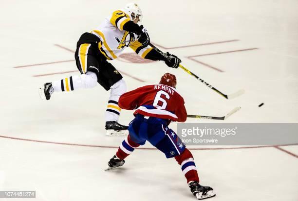 Washington Capitals defenseman Michal Kempny moves in as Pittsburgh Penguins center Evgeni Malkin shoots during a NHL game between the Washington...