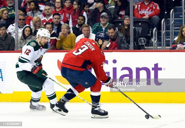 Washington Capitals defenseman Nick Jensen skates against Minnesota Wild center Eric Staal in the first period on March 22 at the Capital One Arena...