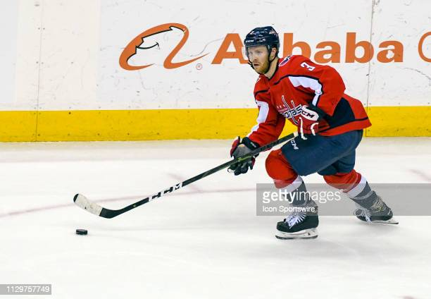 Washington Capitals defenseman Nick Jensen skates up ice with the puck in the third period against the Winnipeg Jets on March 10 at the Capital One...