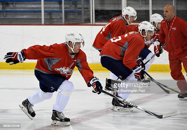 Washington Capitals Development Camp player Miles Koules left joins his teammates in a drill during the first day of the camp at Kettler Capitals...