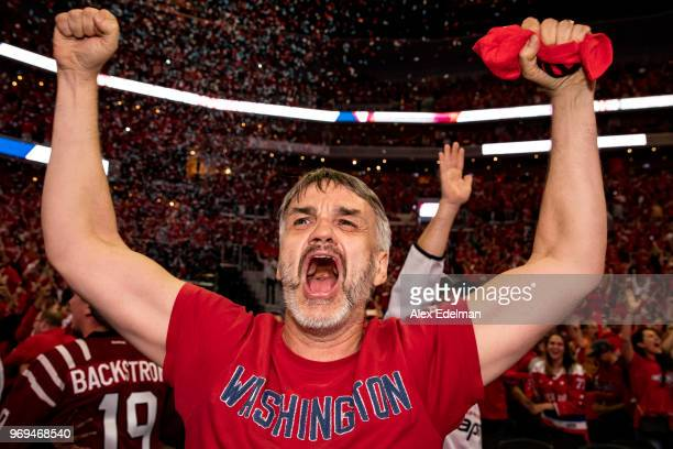 Washington Capitals fan celebrates after the Washington Capitals win Game 5 of the Stanley Cup Final against the Vegas Golden Nights to capture the...