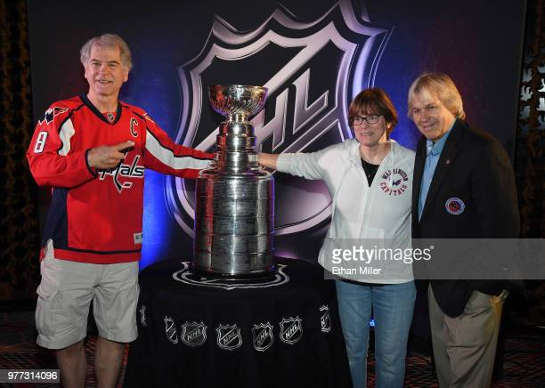Guests take photos of the Conn Smythe Trophy the Frank J Selke Trophy the Presidents' Trophy the Lady Byng Memorial Trophy and the Calder Memorial...