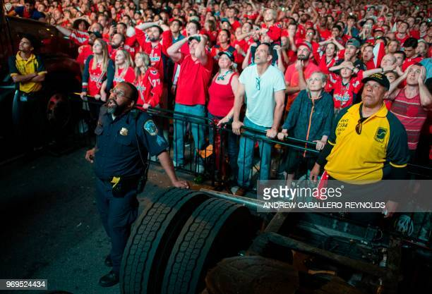 Washington Capitals fans react during Game 5 of the Stanley Cup Final against the Vegas Golden Knights at a watch party on the streets in Washington...