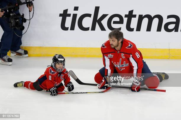 Washington Capitals forward Alexander Ovechkin warms up with fouryearold Jonas Smailys during warm ups before the NHL AllStar Skills Competition on...