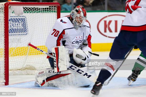 Washington Capitals goalie Braden Holtby blocks a shot during the hockey game between the Washington Capitals and Dallas Stars on December 19 2017 at...