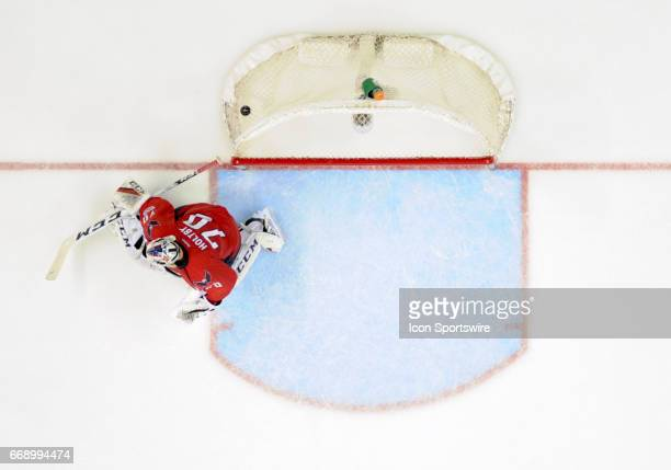 Washington Capitals goalie Braden Holtby deflects a shot in the second overtime against the Toronto Maple Leafs on April 15 at the Verizon Center in...