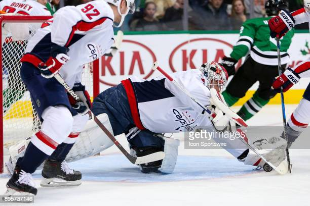 Washington Capitals goalie Braden Holtby dives on a puck during the hockey game between the Washington Capitals and Dallas Stars on December 19 2017...
