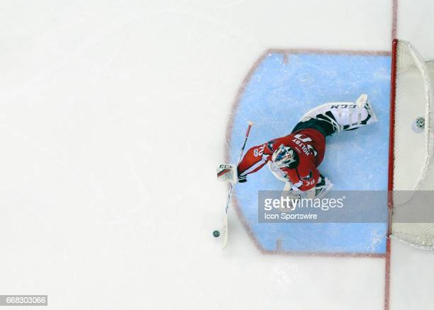 Washington Capitals goalie Braden Holtby dives to make a third period save against the Toronto Maple Leafs on April 13 at the Verizon Center in...