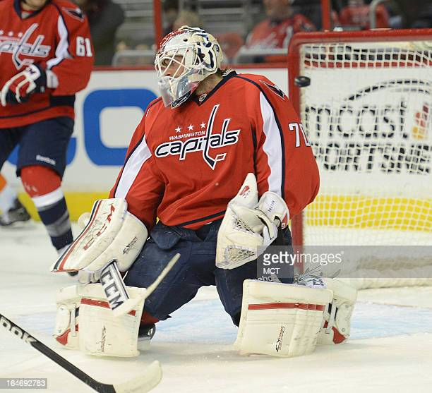 Washington Capitals goalie Braden Holtby gets beat for a goal on a shot by New York Islanders center Josh Bailey, not pictured, in the first period...