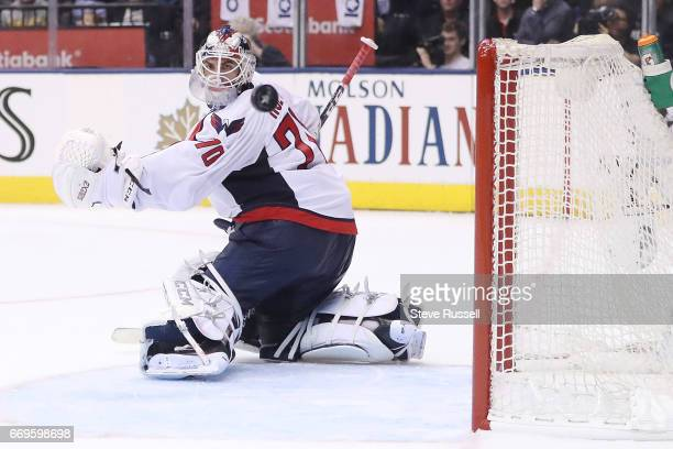 TORONTO ON APRIL 17 Washington Capitals goalie Braden Holtby gets enough of the puck to knock it away as the Toronto Maple Leafs play the Washington...