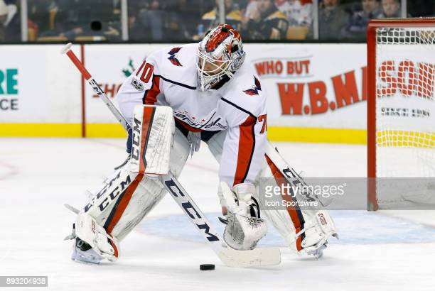 Washington Capitals goalie Braden Holtby holds the pouck up during a game between the Boston Bruins and the Washington Capitals on December 14 at TD...