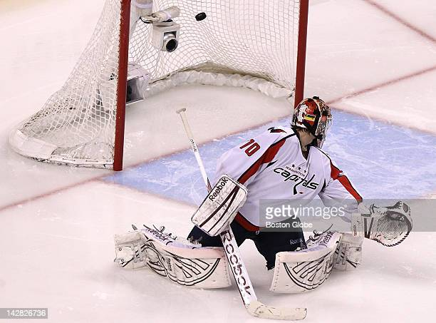 Washington Capitals goalie Braden Holtby looks behind himself as the game winning goal sails into the net scored by Boston Bruins center Chris Kelly...
