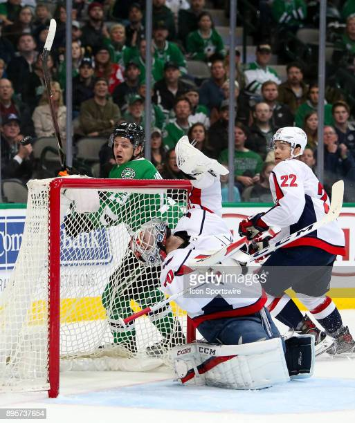 Washington Capitals goalie Braden Holtby looks straight up after a puck is deflected during the hockey game between the Washington Capitals and...