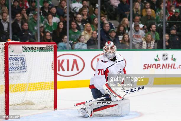 Washington Capitals goalie Braden Holtby looks up at a deflected puck during the hockey game between the Washington Capitals and Dallas Stars on...