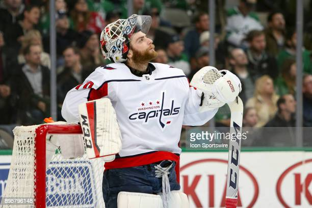 Washington Capitals goalie Braden Holtby looks up at the scoreboard during the hockey game between the Washington Capitals and Dallas Stars on...