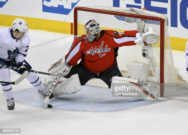 Washington Capitals goalie Braden Holtby makes a first period save on a shot by Toronto Maple Leafs left wing James van Riemsdyk on April 15 at the...