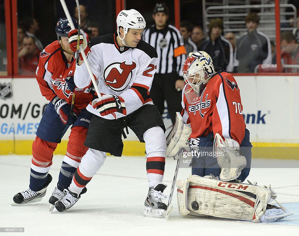 Washington Capitals goalie Braden Holtby (70) makes a save as New Jersey Devils center David Clarkson (23) looks for a rebound in the first period at the Verizon Center in Washington, D.C., Thursday, February 21, 2013.