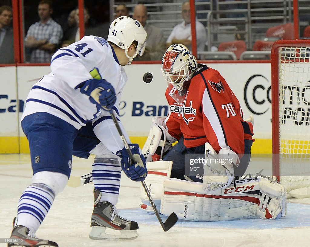 Washington Capitals goalie Braden Holtby (70) makes a save as Toronto Maple Leafs left wing Nikolai Kulemin (41) looks for a rebound in the first period at the Verizon Center in Washington, D.C., Tuesday, April 16, 2013.