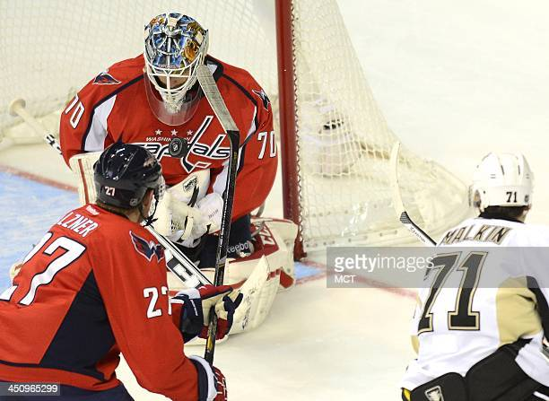 Washington Capitals goalie Braden Holtby makes a save on a shot by Pittsburgh Penguins center Evgeni Malkin in the third period at the Verizon Center...