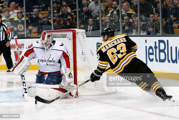 Washington Capitals goalie Braden Holtby makes the save on Boston Bruins left wing Brad Marchand during a game between the Boston Bruins and the...