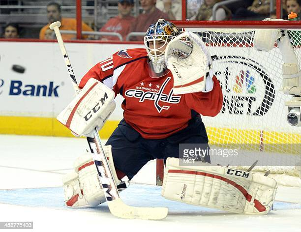 Washington Capitals goalie Braden Holtby prepares to make a glove save against the New Jersey Devils in the first period at the Verizon Center in...