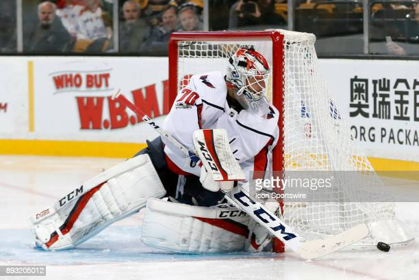 Washington Capitals goalie Braden Holtby pushes the puck away during a game between the Boston Bruins and the Washington Capitals on December 14 at...