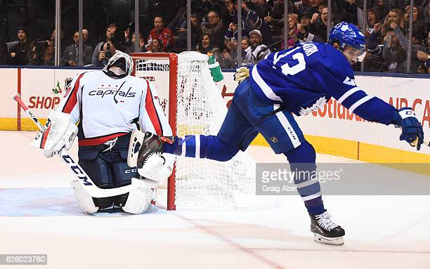 Washington Capitals goalie Braden Holtby reacts after a goal by Toronto Maple Leafs' Nazem Kadri during the third period at the Air Canada Centre on...