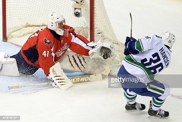 Washington Capitals goalie Jaroslav Halak makes a glove save against Vancouver Canucks right wing Jannik Hansen in the third period at the Verizon...
