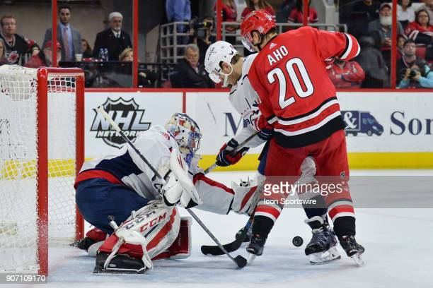 Washington Capitals Goalie Philipp Grubauer attempts to locate a puck in front of Carolina Hurricanes Left Wing Sebastian Aho during a game between...
