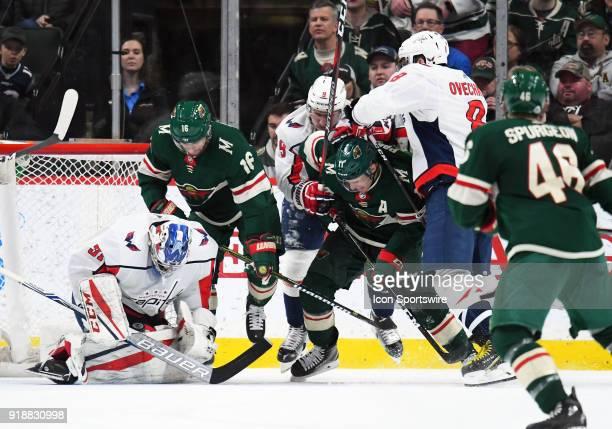 Washington Capitals Goalie Philipp Grubauer corrals a loose puck as Minnesota Wild Left Wing Jason Zucker Washington Capitals Defenceman Dmitry Orlov...