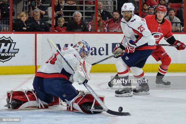 Washington Capitals Goalie Philipp Grubauer makes a save in front of Washington Capitals Right Wing Devante SmithPelly during a game between the...