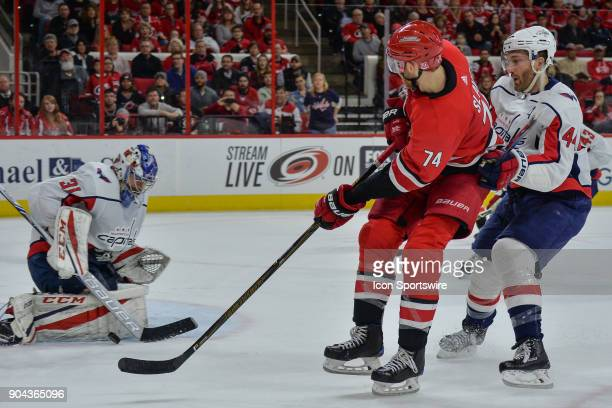 Washington Capitals Goalie Philipp Grubauer makes a save on a shot attempt by Carolina Hurricanes Defenceman Jaccob Slavin during a game between the...