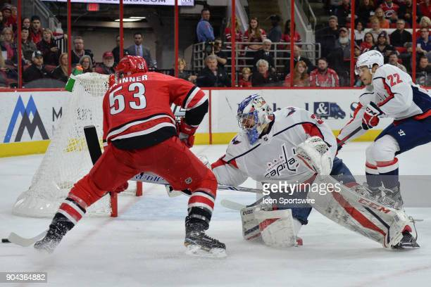Washington Capitals Goalie Philipp Grubauer skates out aggressively to defend a shot attempt by Carolina Hurricanes Left Wing Jeff Skinner during a...