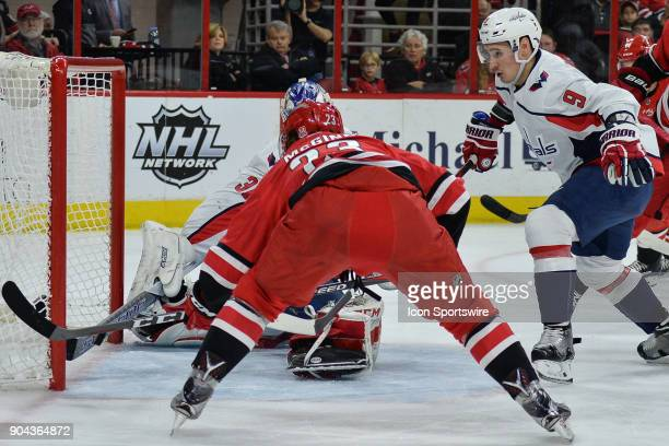 Washington Capitals Goalie Philipp Grubauer stops a shot attempt by Carolina Hurricanes Left Wing Brock McGinn with his stick on the goal line during...
