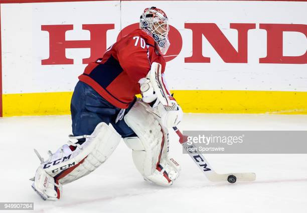 Washington Capitals goaltender Braden Holtby comes out of his goal to intercept the puck during the first round Stanley Cup playoff game 5 between...