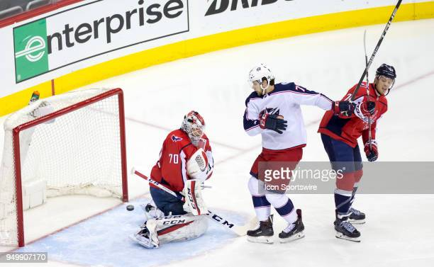 Washington Capitals goaltender Braden Holtby deflects a shot by Columbus Blue Jackets right wing Josh Anderson during the first round Stanley Cup...