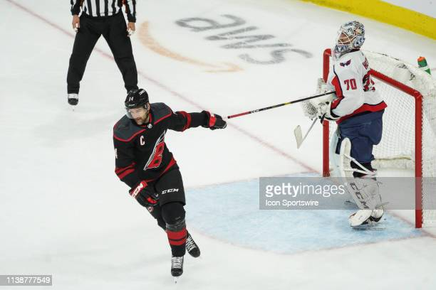 Washington Capitals goaltender Braden Holtby grabs hold of the stick of Carolina Hurricanes Right Wing Justin Williams during a game between the...