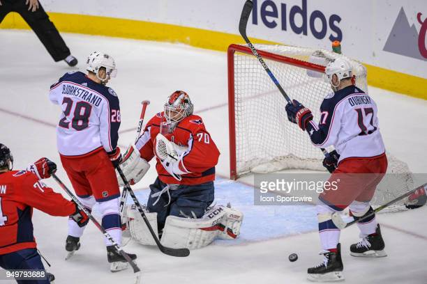 Washington Capitals goaltender Braden Holtby has the puck ricochet off of him after a second period shot by Columbus Blue Jackets right wing Oliver...