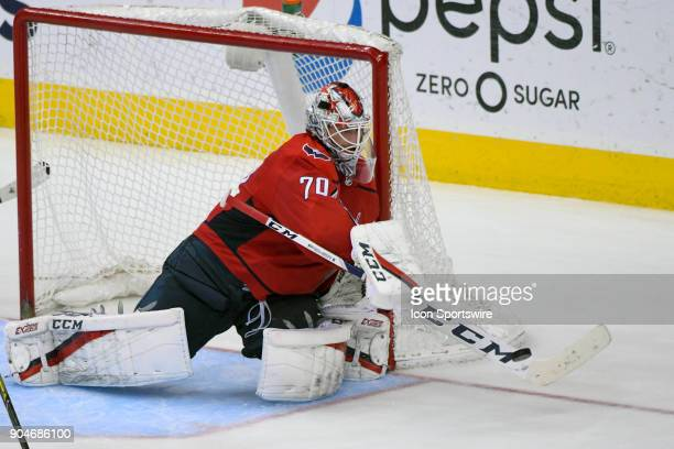 Washington Capitals goaltender Braden Holtby knocks the puck away in the third period against the Carolina Hurricanes on January 11 at the Capital...