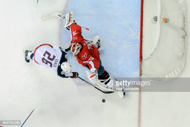 Washington Capitals goaltender Braden Holtby makes a first period save on shot by Columbus Blue Jackets left wing Thomas Vanek on April 21 at the...