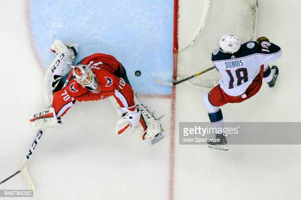 Washington Capitals goaltender Braden Holtby makes a save on a third period shot by Columbus Blue Jackets center PierreLuc Dubois on April 21 at the...