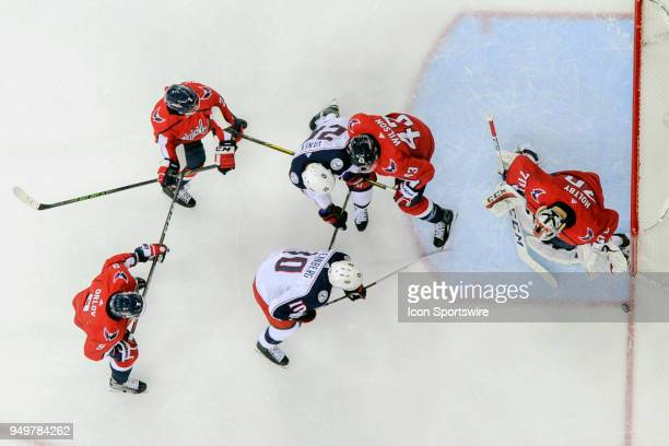 Washington Capitals goaltender Braden Holtby makes a save on a third period shot by Columbus Blue Jackets center Alexander Wennberg on April 21 at...