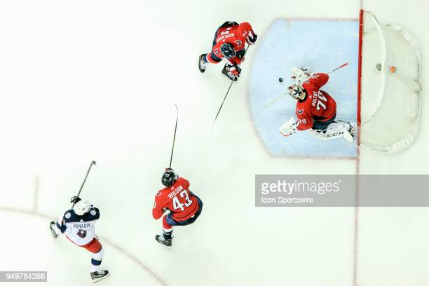 Washington Capitals goaltender Braden Holtby makes a save on a third period shot by Columbus Blue Jackets left wing Artemi Panarin on April 21 at the...