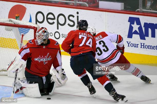 Washington Capitals goaltender Braden Holtby makes a save on shot by Carolina Hurricanes left wing Jeff Skinner on January 11 at the Capital One...