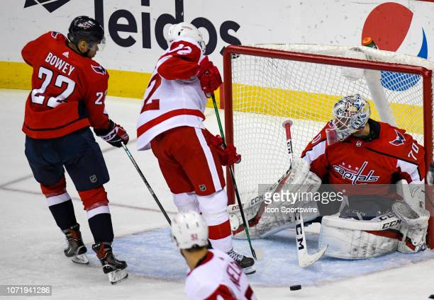 Washington Capitals goaltender Braden Holtby makes a third period save on shot by Detroit Red Wings center Andreas Athanasiou on December 11 at the...