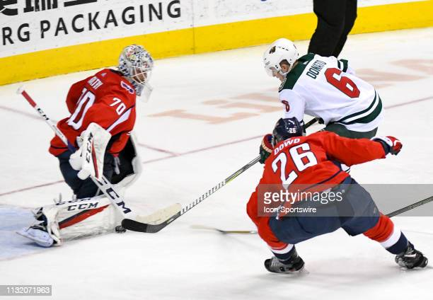 Washington Capitals goaltender Braden Holtby makes a third period save on a shot by Minnesota Wild center Ryan Donato on March 22 at the Capital One...