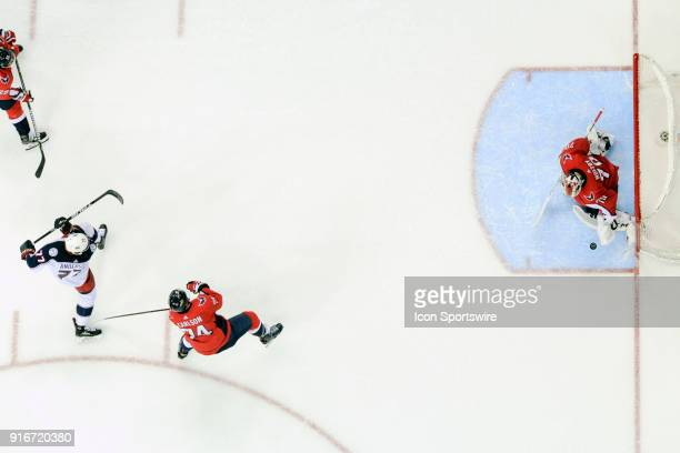 Washington Capitals goaltender Braden Holtby makes a third period on a shot by Columbus Blue Jackets right wing Josh Anderson in action on February 9...