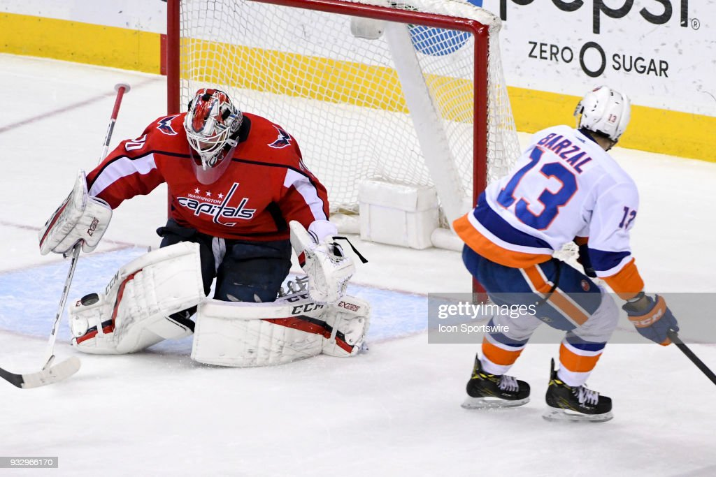 Washington Capitals goaltender Braden Holtby (70) makes a third period save on a shot by New York Islanders center Mathew Barzal (13) on March 16, 2018, at the Capital One Arena in Washington, D.C. The Washington Capitals defeated the New York Islanders, 6-3.