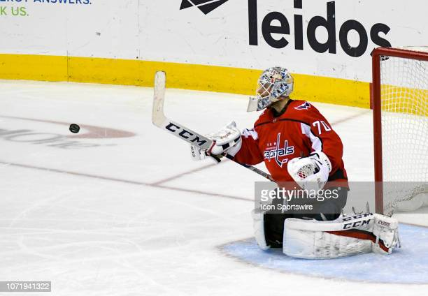 Washington Capitals goaltender Braden Holtby makes a third period stick save on a shot by the Detroit Red Wings on December 11 at the Capital One...
